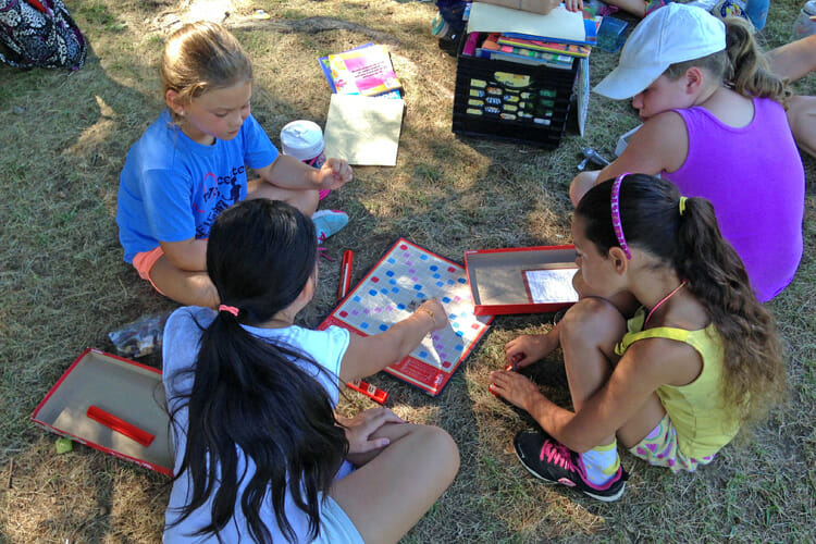 Worcester youth participating in literacy activities during the Tenacity Summer Tennis and Reading Program