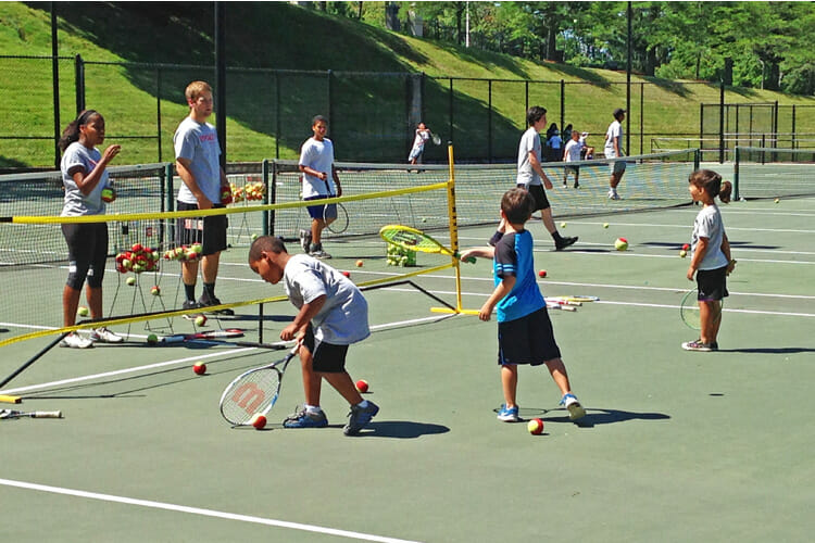 Worcester youth playing tennis in the Tenacity Summer Tennis and Reading Program